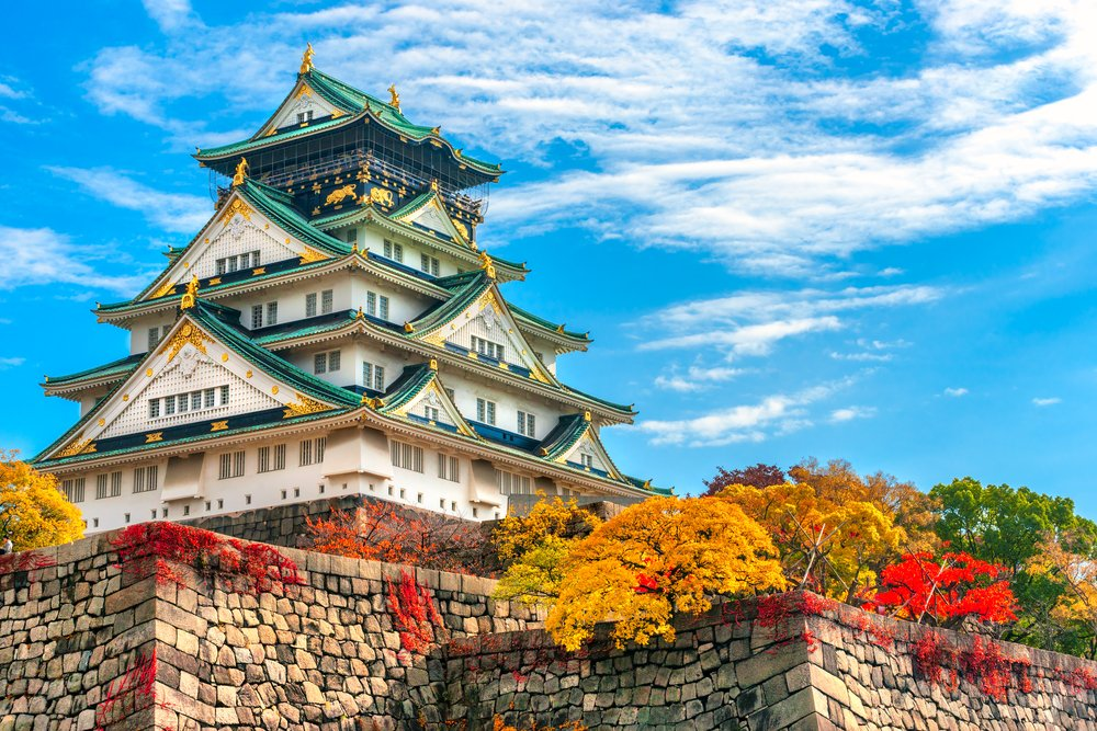 Osaka Castle in Osaka with autumn leaves