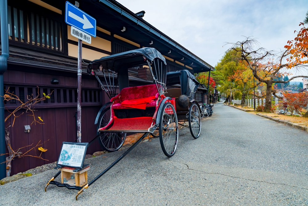 Japanese rickshaw or old style two wheeled passenger cart in Takayama world heritage site
