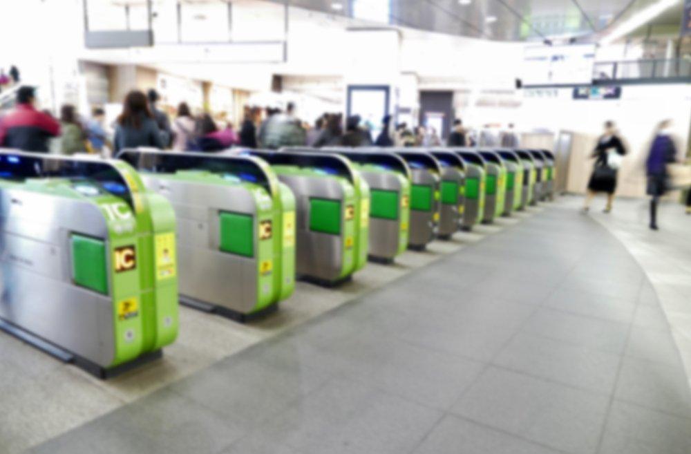 blurred electronic gates at train station using IC card in Shinjuku, Tokyo, Japan