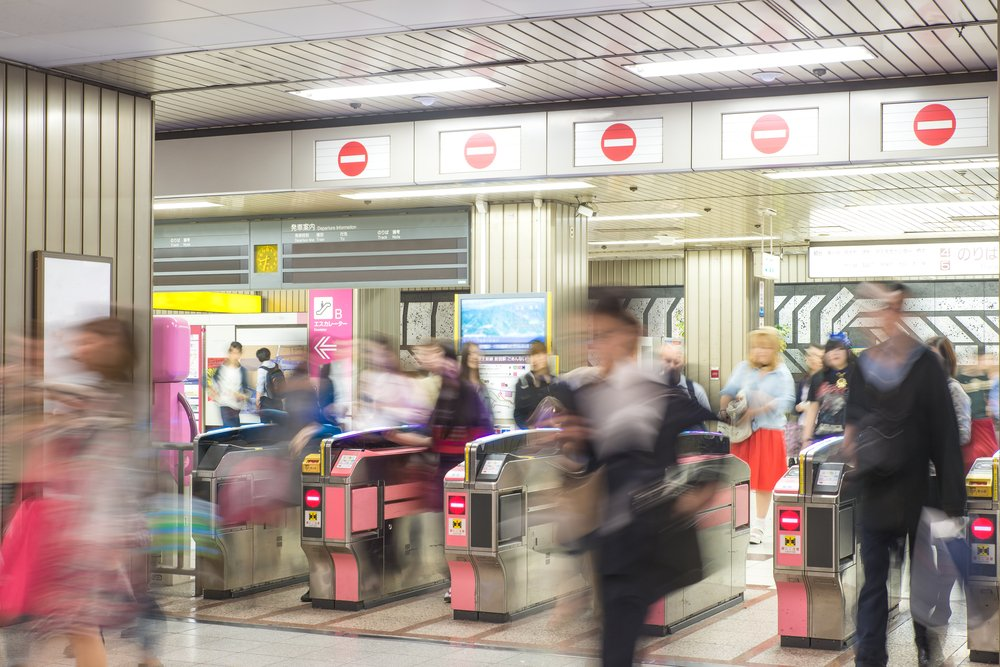 Blurred abstract background of many people at subway station in Tokyo