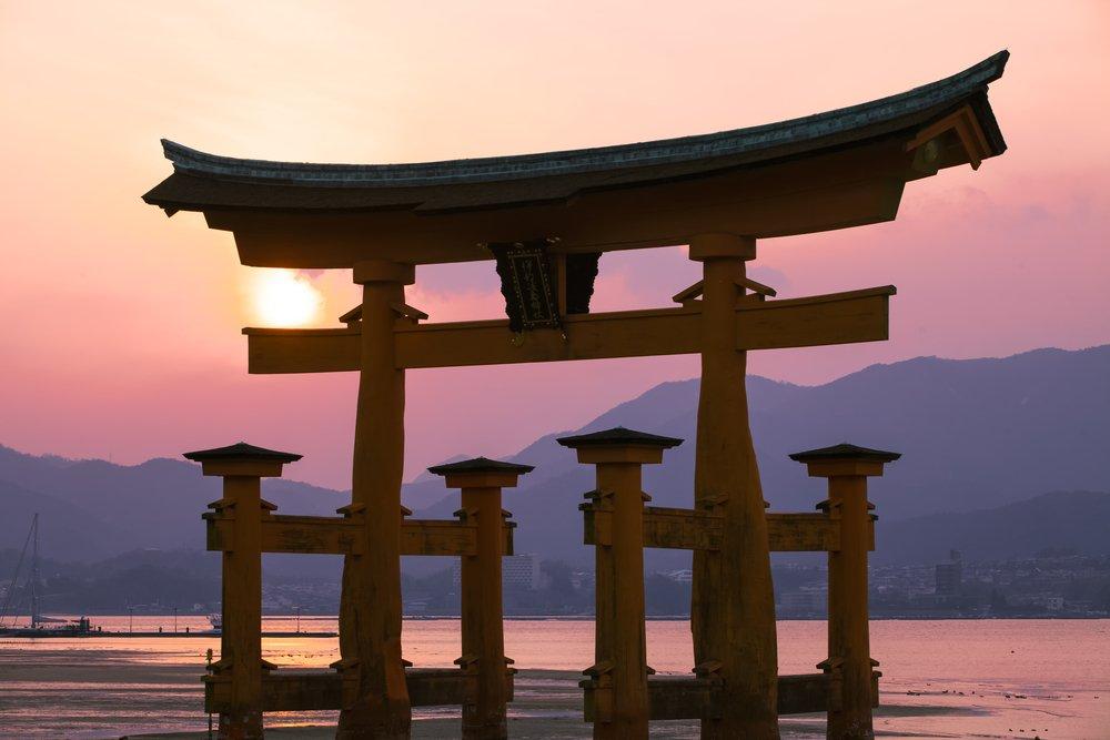 The great Torii Symbol of Miyajima island in sunset tiwilight