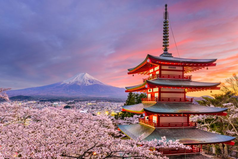 Fujiyoshida, Japan at Chureito Pagoda and Mt. Fuji in the spring with cherry blossoms