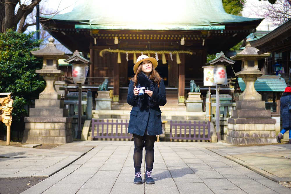 sian woman photographer is enjoy traveling into Ueno Park in Tokyo